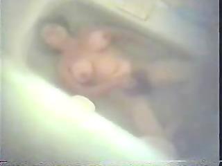 hirsute mom masturbating in washroom tube.