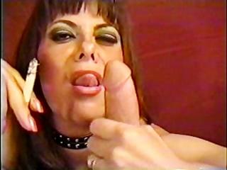 mature woman engulfing smoke and manmeat