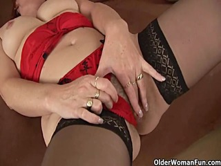 lewd granny in nylons is dildoing her unshaved