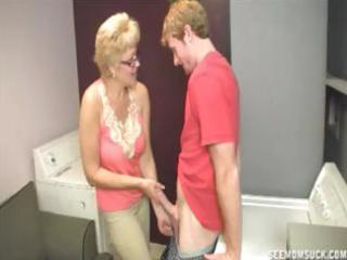blonde granny teaches her young grandson the joys