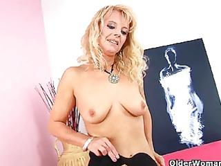 blonde grandma in dark stockings fucks herself