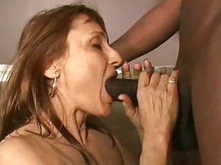 sexy milf gives blowjob to darksome dick