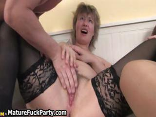 sexually excited mature woman receives her wet